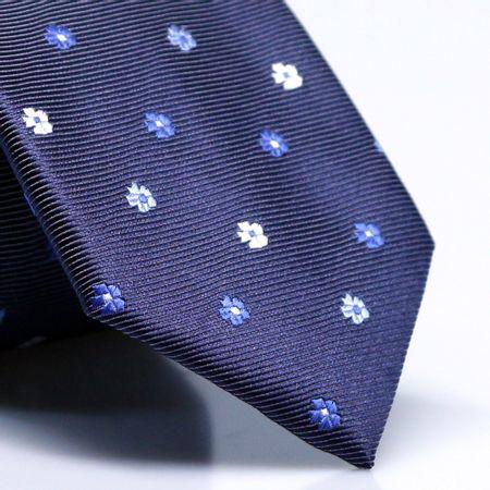 gravata-petit-floral-em-jacquard-de-poliester-azul-marinho-com-flores-em-tons-de--branco-e-azul1